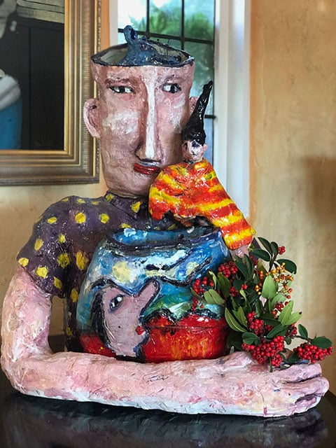 Puppeteer with red and yellow berries.