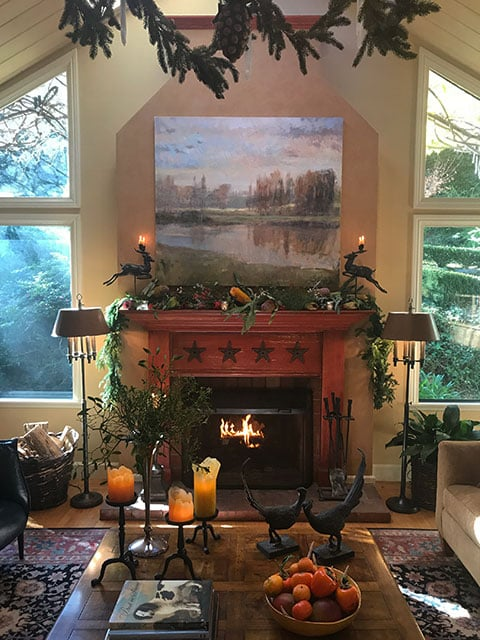 The starry red mantel lends a festive air to the cottage year round