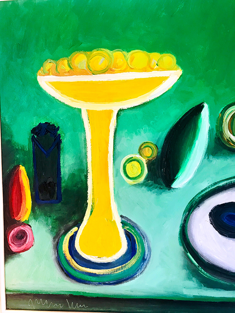 Lemons in the artwork in a tall footed yellow bowl.